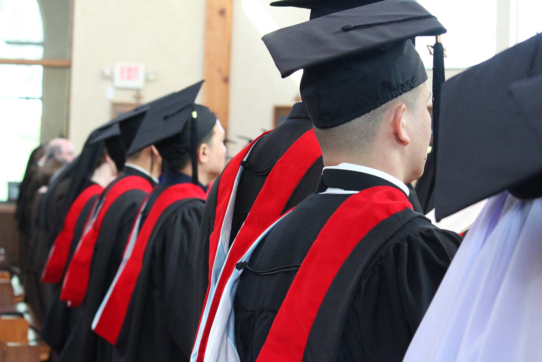 Graduates in pew
